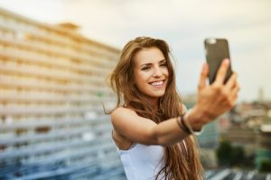 girl takes selfie on rooftop